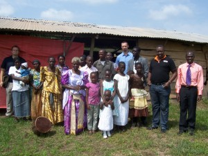 Pastor Daniel (far right) with his congregation in Iganga